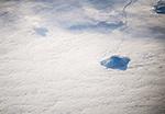 Камчатка. Одинокий вулкан в море облаков
